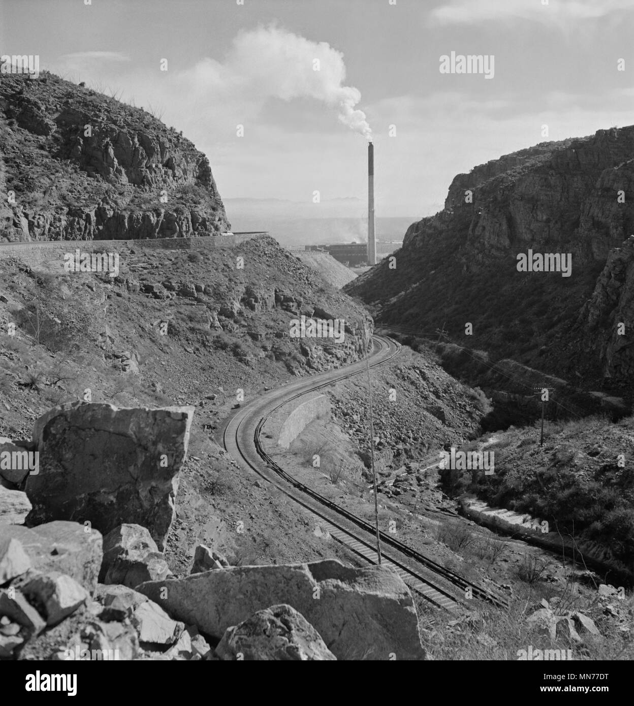 Industrial Railroad and Smokestack of Large Copper Smelter that Supplies Great Quantities of Copper so vital to War Effort, Phelps-Dodge Mining Company, Morenci, Arizona, USA, Fritz Henle for Office of War Information, December 1942 Stock Photo