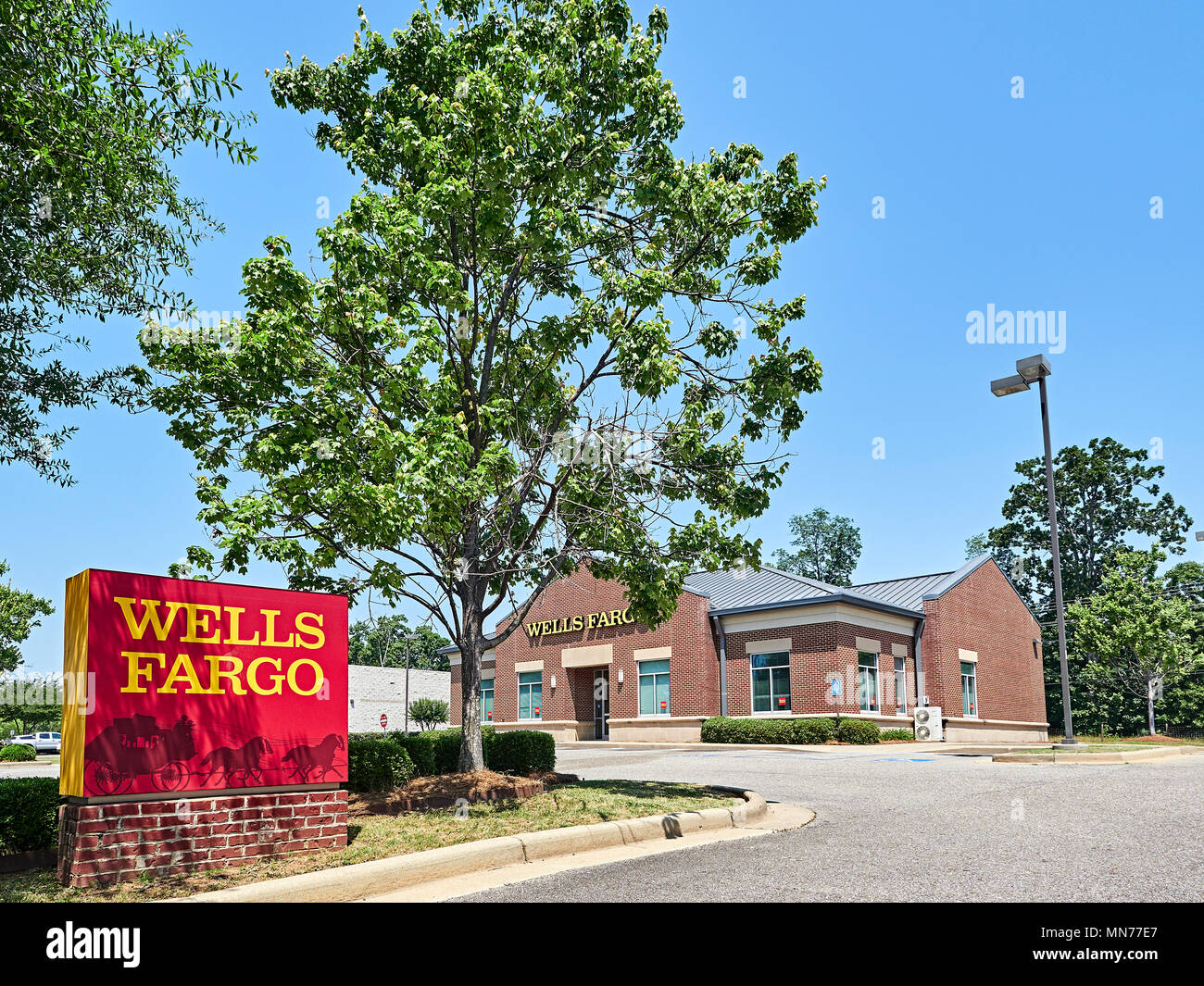 Wells Fargo Bank branch sign, with corporate logo, exterior and entrance in Montgomery Alabama, USA. - Stock Image