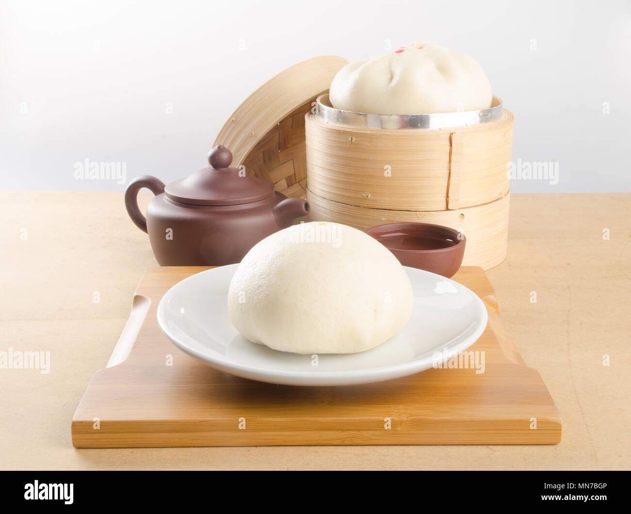 pao or dim sum in bamboo steamer with chinese bun stock photo
