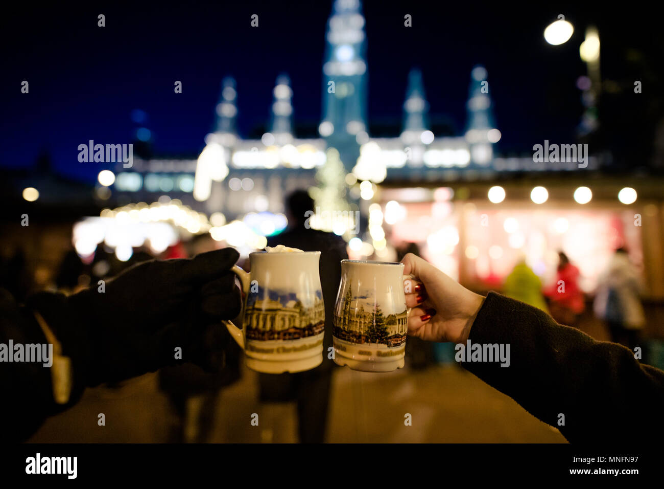 People holding traditional Punch cups in Vienna Christmas Market, December 2016 - Stock Image