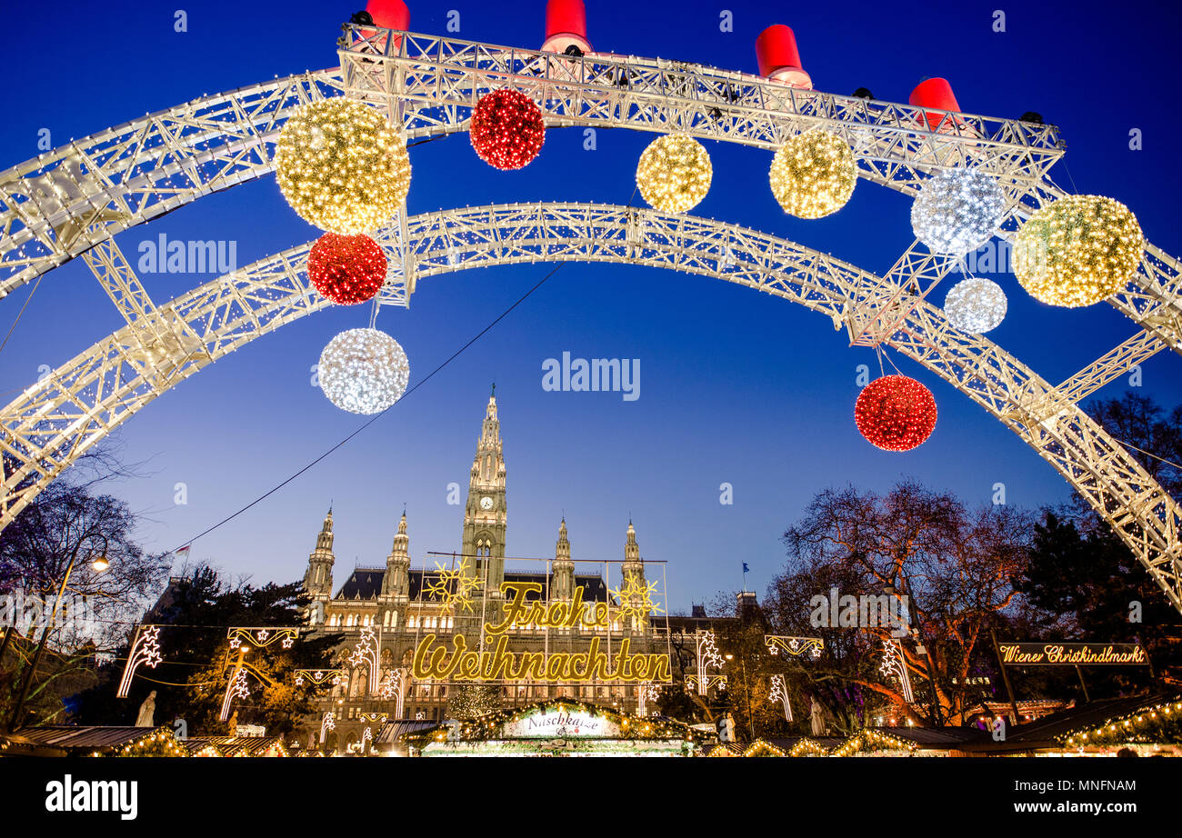 The traditional Christmas Market with decorations in fornt of the City Hall (Rathaus), Wien, Austria, Europe - Stock Image