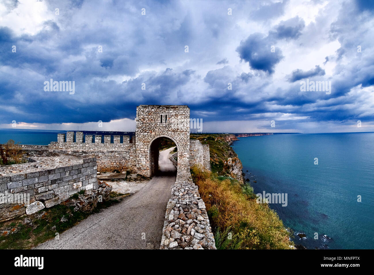 Cape Kaliakra fortress, Bulgaria, dramatic storm comming at Black Sea. Old abandoned fortress by the sea. Important trousitic attraction. - Stock Image