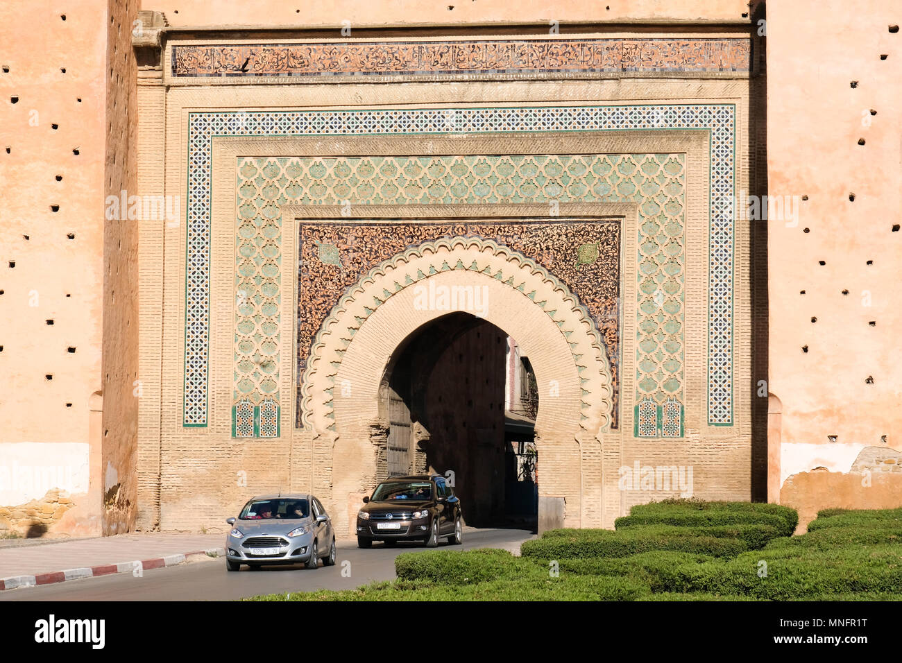 Meknes old city gate with traditional architecture - Morocco - Stock Image