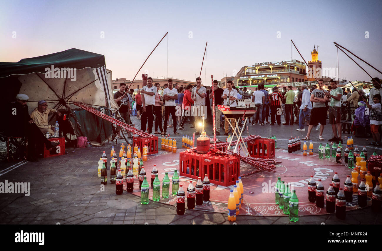 MARRAKECH, MOROCCO, JUNE 2016: people playing traditional games in Jama el-Fna market, important touristic attraction - Stock Image