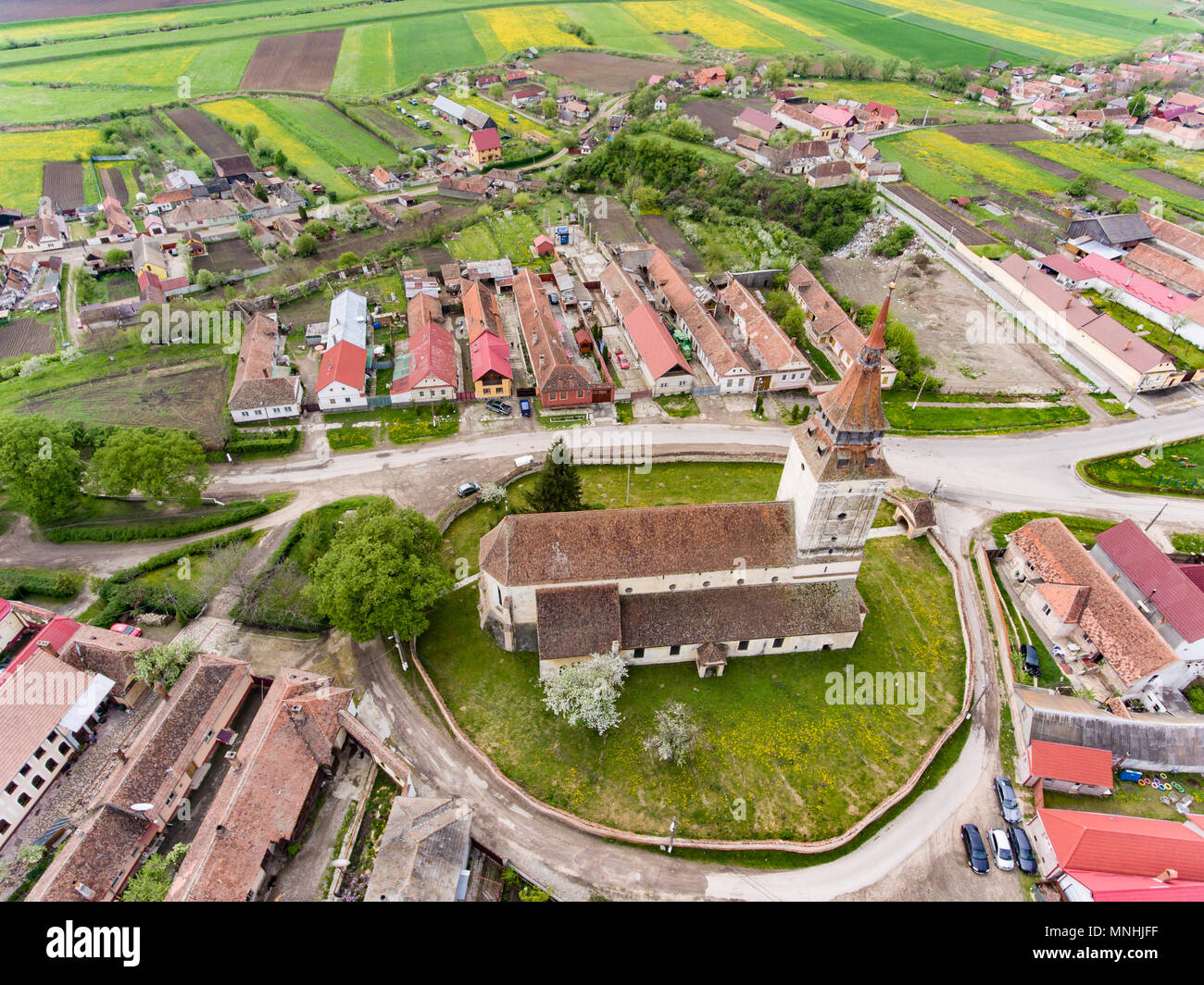 Feldioara fortified Church near Brasov, Transilvania, Romania. Aerial view from a drone. - Stock Image