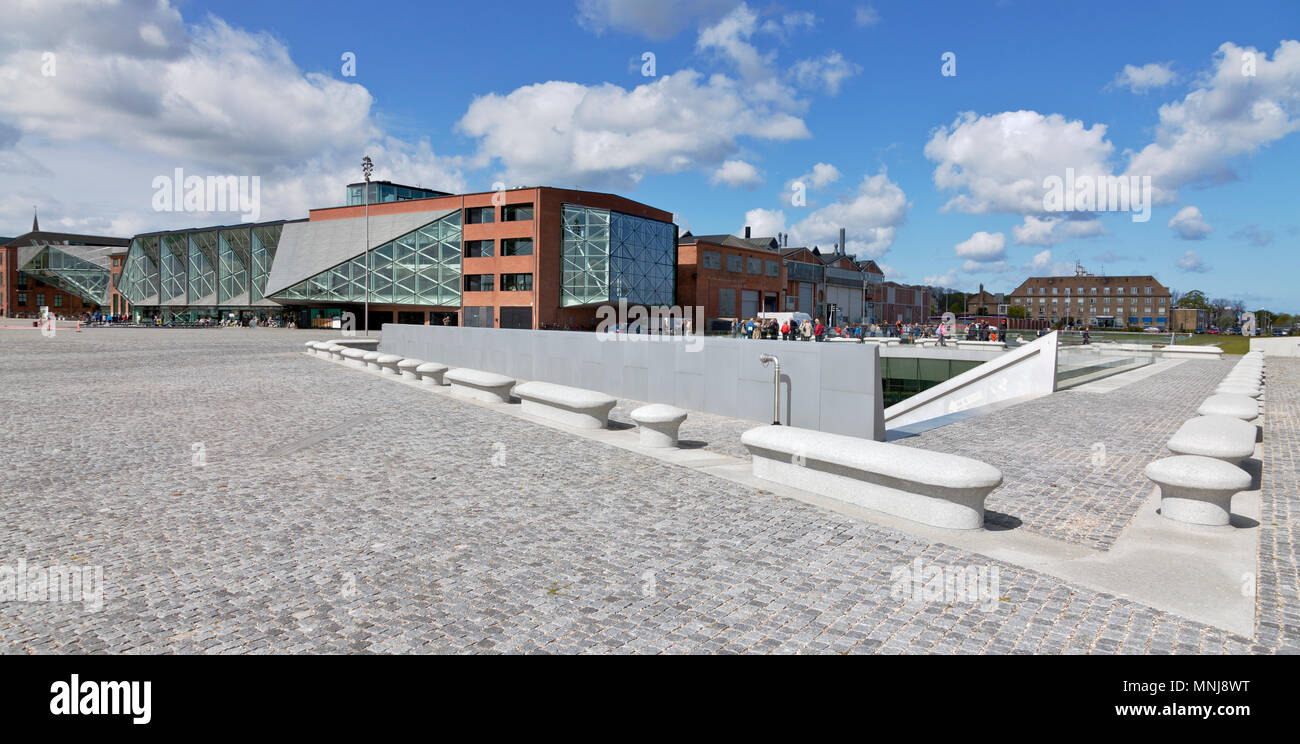 The underground Danish Maritime Museum next to the Culture Yard in Elsinore / Helsingør, Denmark. Bollards signal a Morse code around Maritime Museum - Stock Image