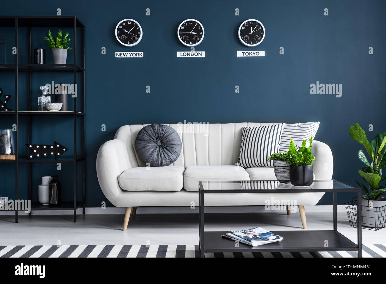 Incroyable Elegant Beige Sofa In A Dark, Navy Blue Living Room Interior With Black  Furniture And Stylish Decor