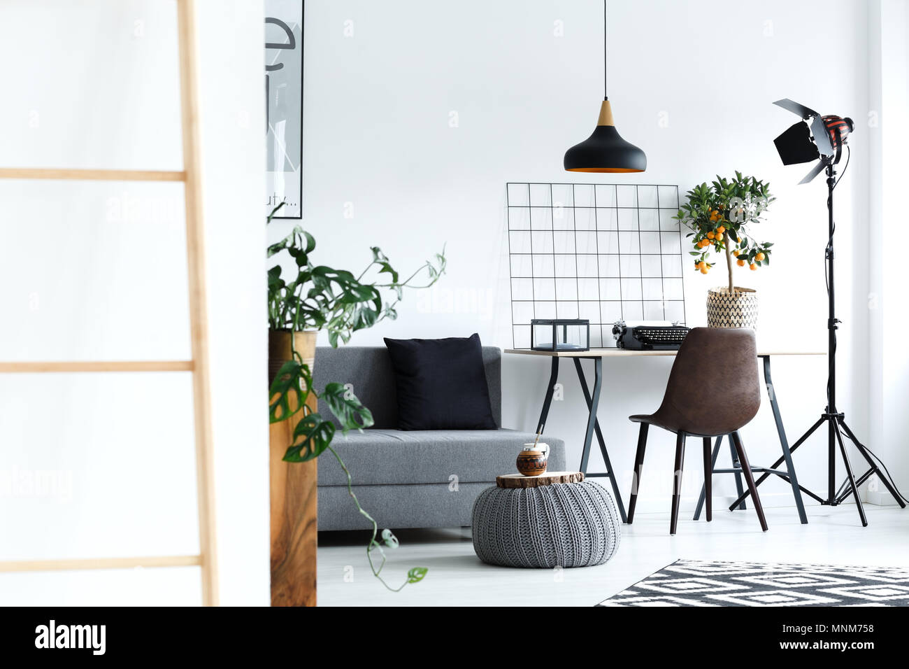 White Minimalist Living Room With Grey Sofa Lamp Desk Ladder