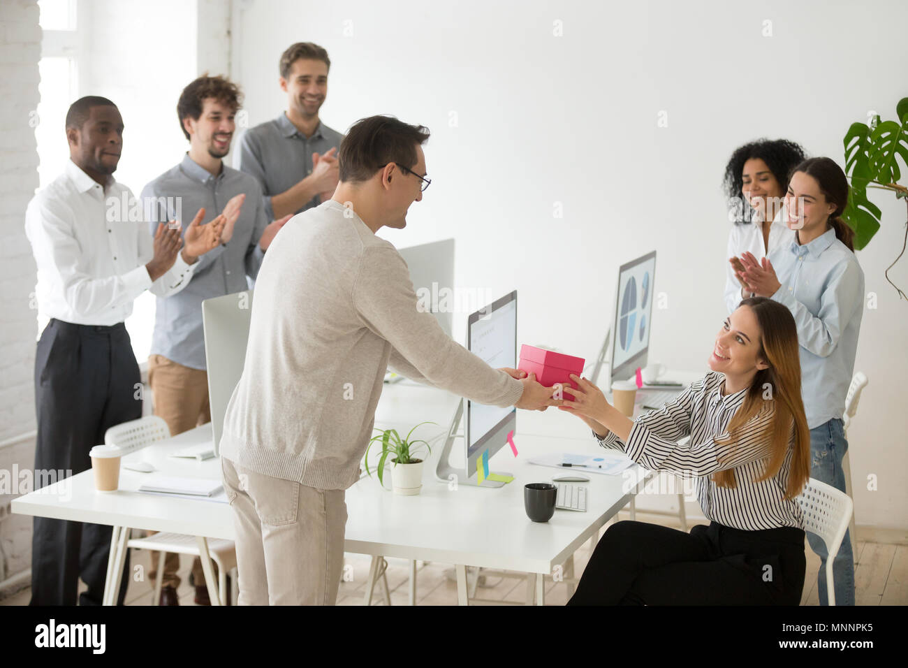Friendly Team Congratulating Female Colleague With Birthday Gift