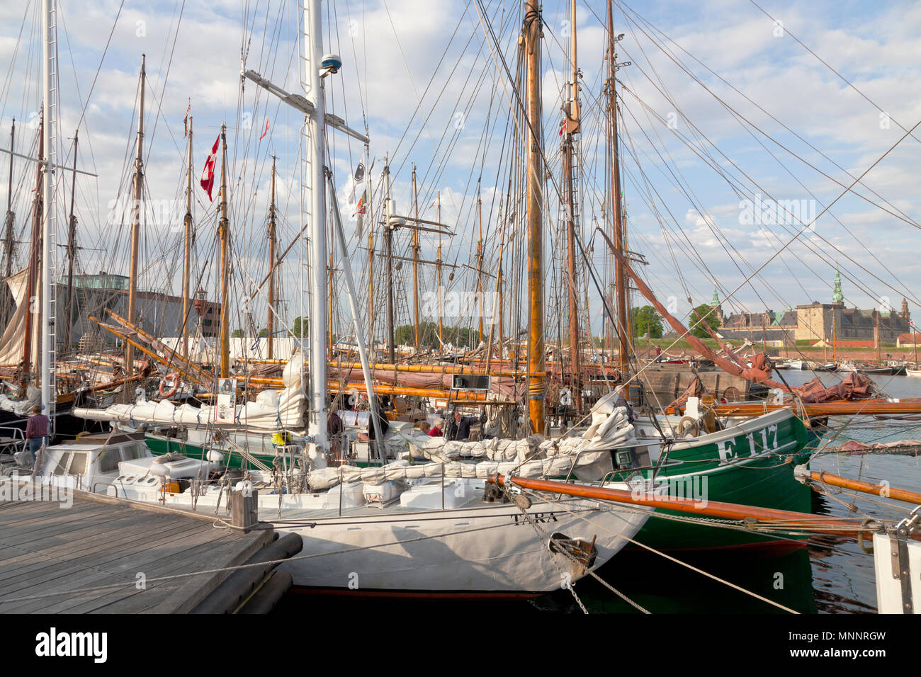Historical days of more than 100 wooden ships in Elsinore at Pentecost or Whitsun in Helsingør, Elsinore, Denmark. Kronborg Castle in distance. - Stock Image
