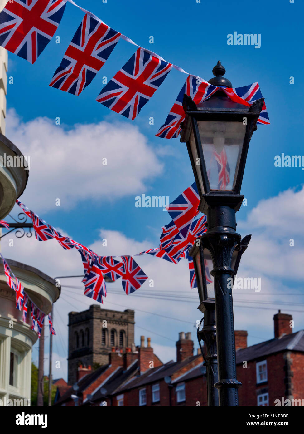 Ashbourne, Derbyshire, UK, 19 May 2018. A typical scene in an English town with Royal Union Jack Flags flying on the day of the Royal wedding in Ashbourne, Derbyshire the gateway to the Peak District National Park Credit: Doug Blane/Alamy Live News - Stock Image