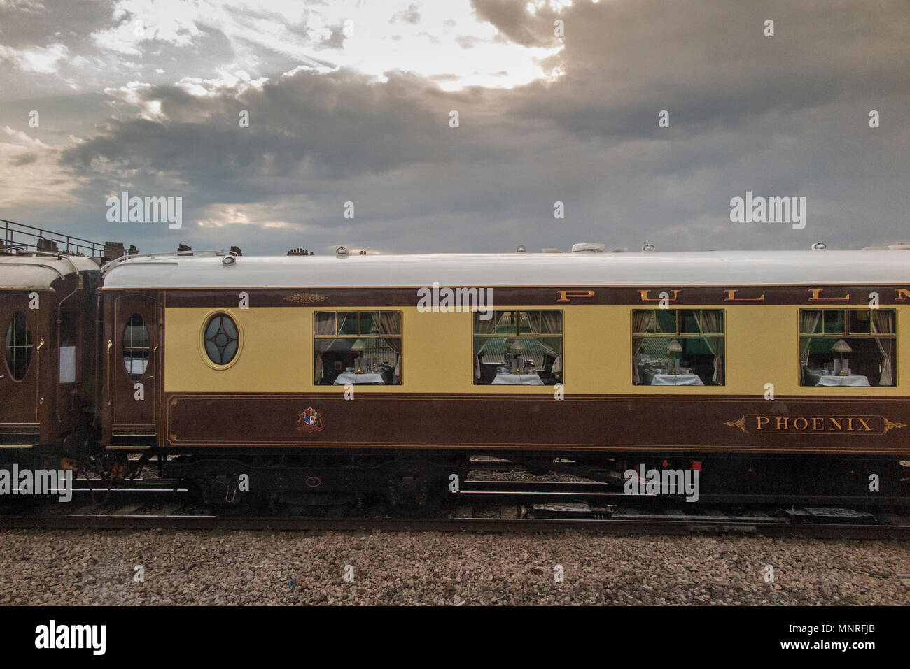 Pullman carriages  being pulled by a steam locomotive in Central London - Stock Image