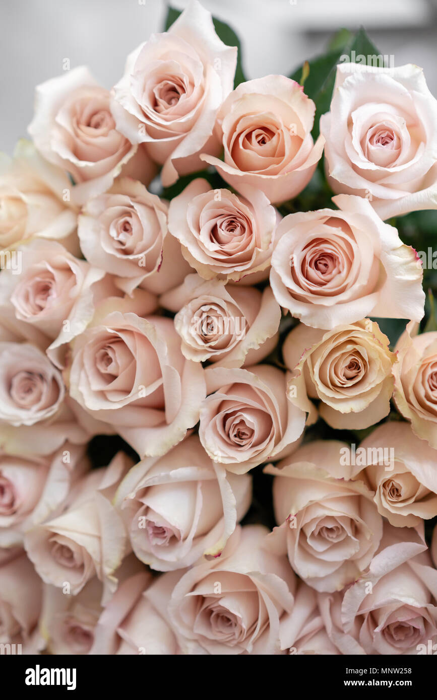 Pastel Pink Roses Bouquet Of Beautiful Flowers On Wooden Table
