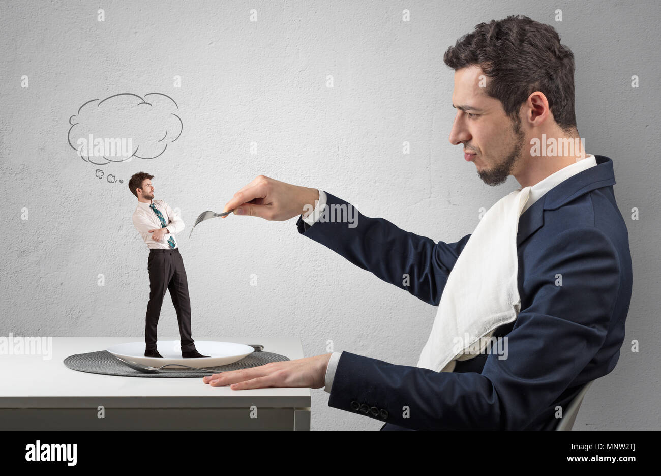 Big businessman want to eat small man with cloud messages above his head  - Stock Image