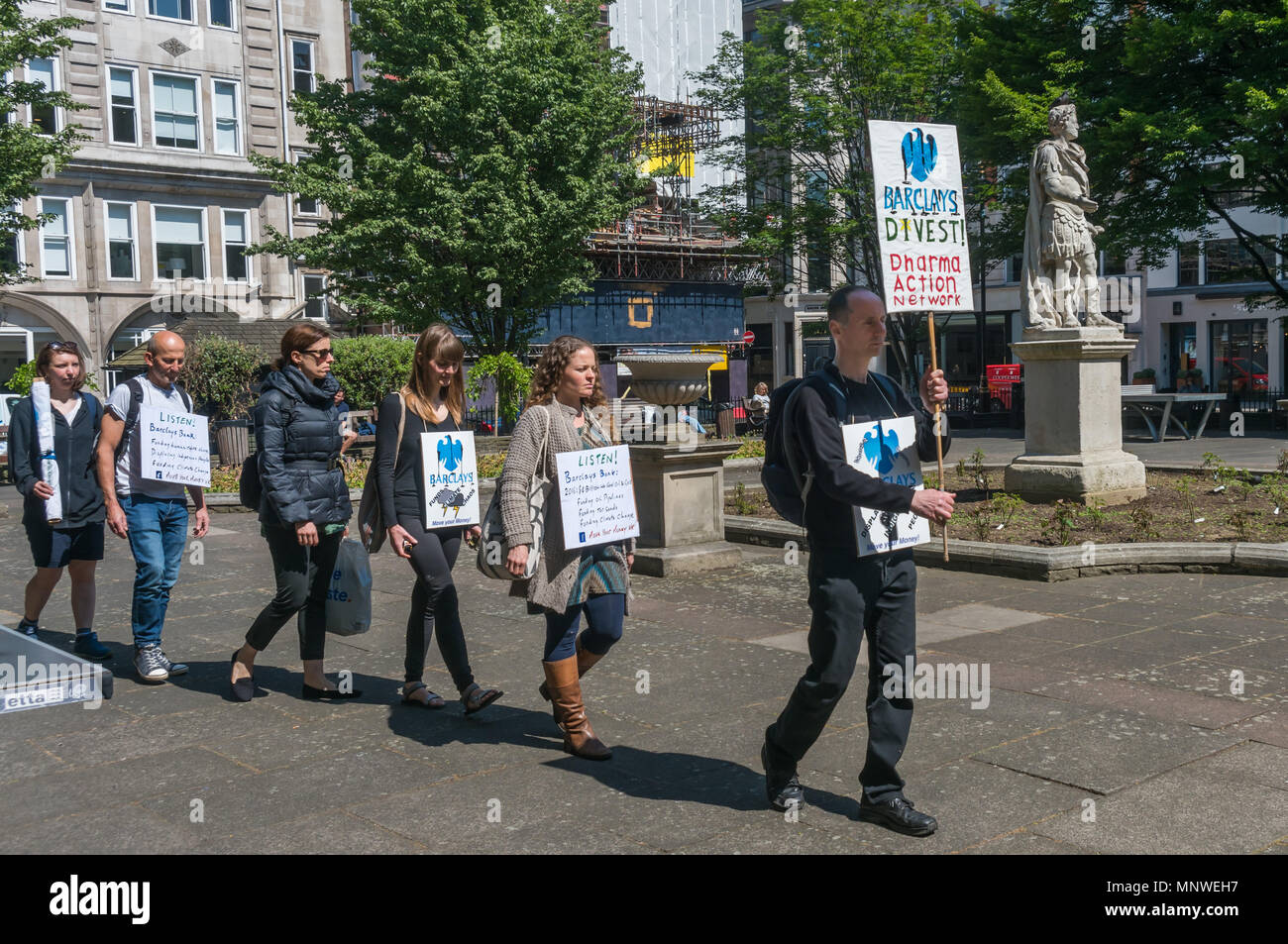London, UK. 19th May 2018. Members of the Dharma Action Network for Climate Engagement (DANCE) march in a silent procession from Golden Square to the Piccadilly Circus branch of Barclays Bank in a monthly vigil to call on them to Stop Funding Climate Chaos. Credit: Peter Marshall/Alamy Live News - Stock Image