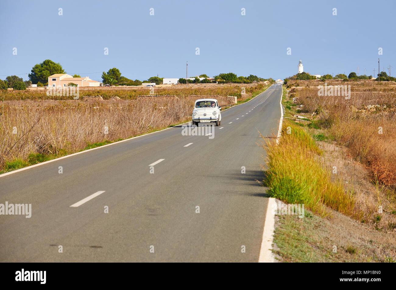 white-vintage-seat-600-e-car-driving-alo