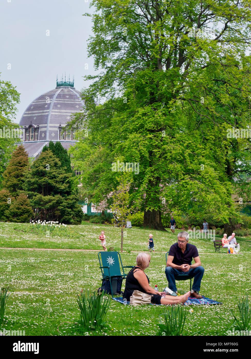 Buxton Victorian Pavilion Gardens, UK. 21st may 2018. Weather UK: People enjoying the warm summer sunshine in the Buxton Victorian Pavilion Gardens, Derbyshire Credit: Doug Blane/Alamy Live News - Stock Image