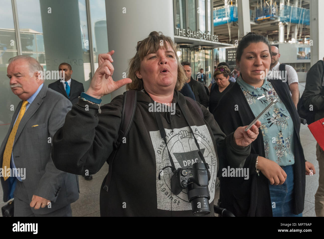 London, UK. 21st May 2018. Paula Peters of DPAC speaks at the 'People's Picket' by disabled rail passengers from Disabled People Against Cuts along with the Association of British Commuters and RMT members outside London Bridge station, reading out a tweet  from GTR compalining that their staff training guide is private. In it, the disabled are dehumanised as 'PRM's  and staff are instructed to leave wheelchair users on the platform, even when they have arranged and pre-booked a journey. Credit: Peter Marshall/Alamy Live News - Stock Image