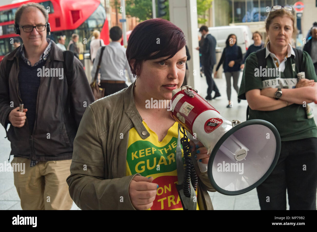 London, UK. 21st May 2018. A speaker from the RMT reiterates their determination to keep fighting GTR to keep guards on the train, insisting that they are essential for passenger safety and to allow disabled people to travel, at the 'People's Picket' by disabled rail passengers from Disabled People Against Cuts along with the Association of British Commuters and RMT members outside London Bridge station. Credit: Peter Marshall/Alamy Live News - Stock Image