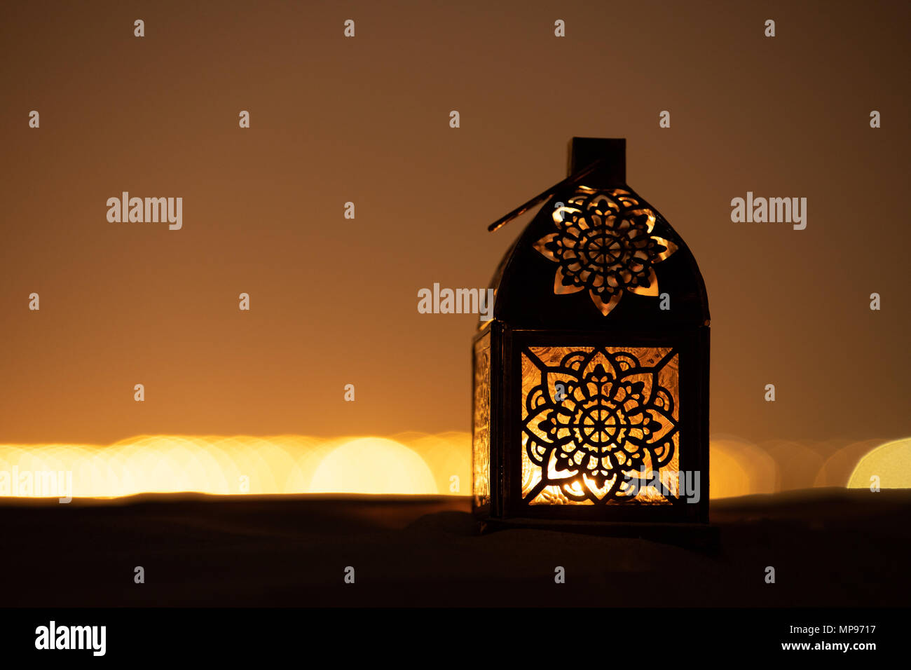 Traditional Ornamental Arabic Lantern With A Burning Candle In