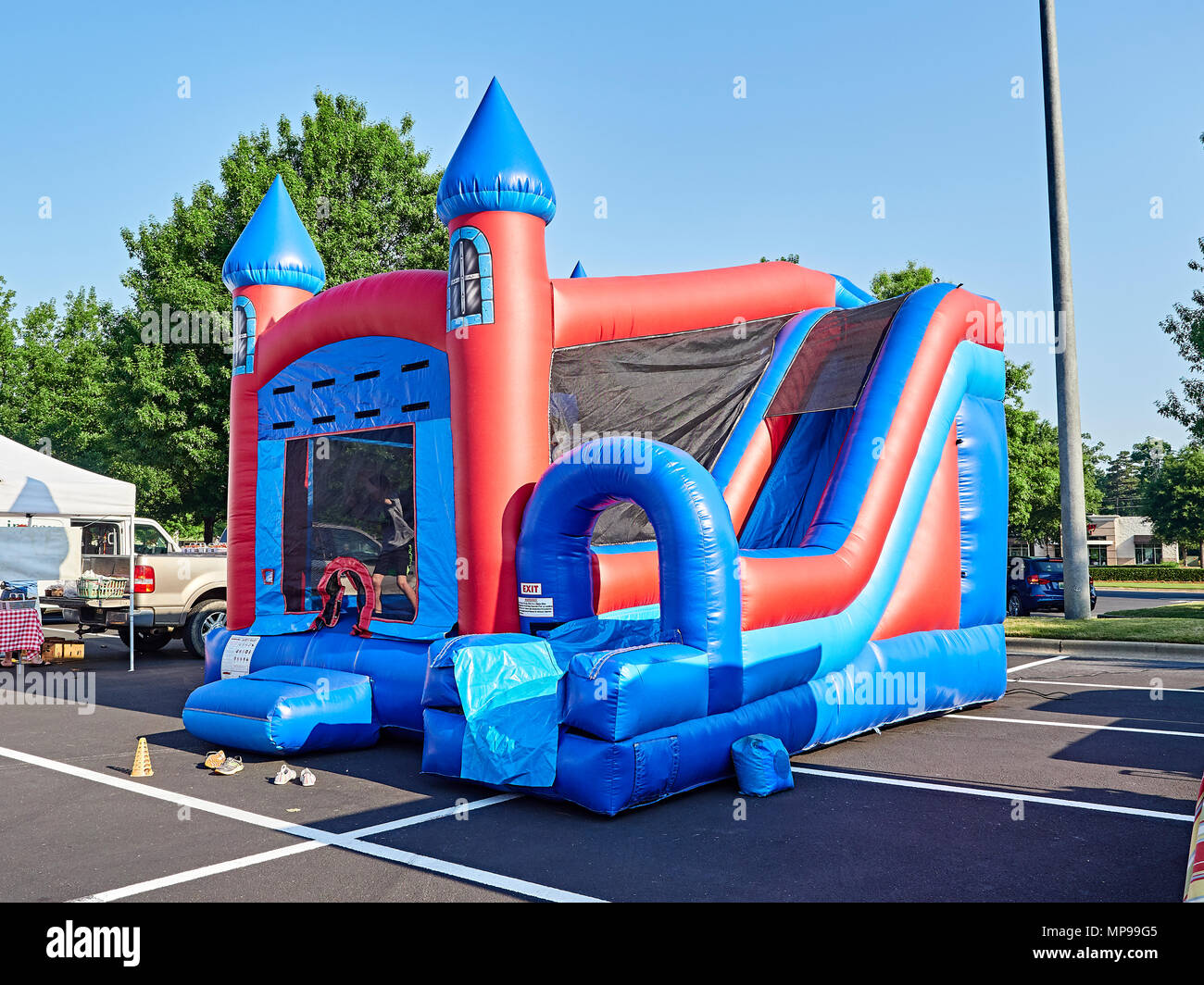 Inflatable bounce or bouncy house in shape of a castle designed for children at a local outdoor market in Montgomery Alabama, USA. - Stock Image