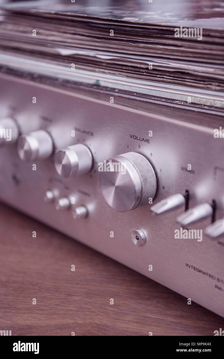 Vinyl records on top of a stereo music amplifier - Stock Image