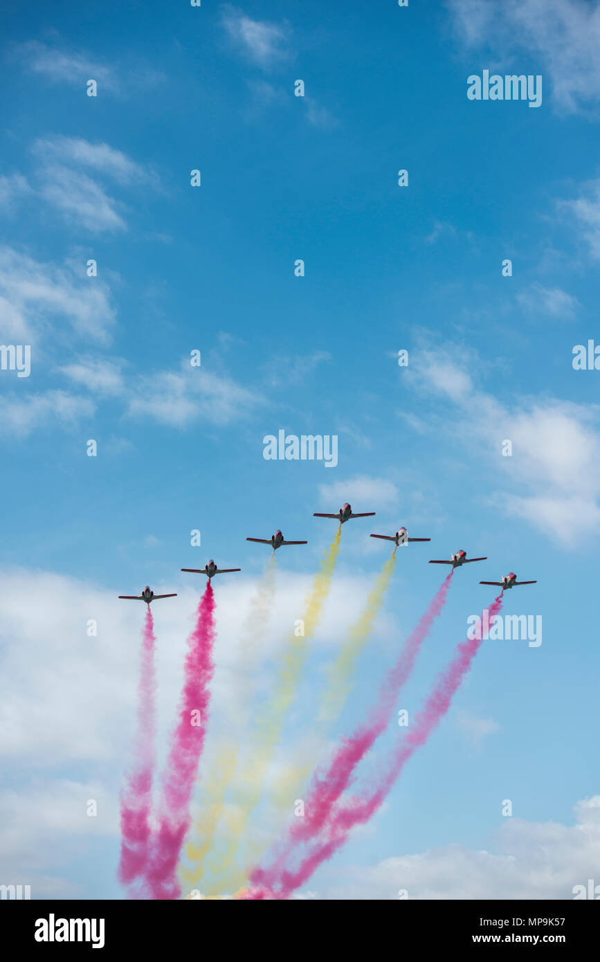 Military jets performing a colourful flypast display - Stock Image