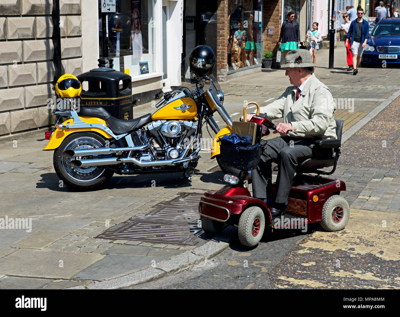senior-man-on-mobility-scooter-admiring-