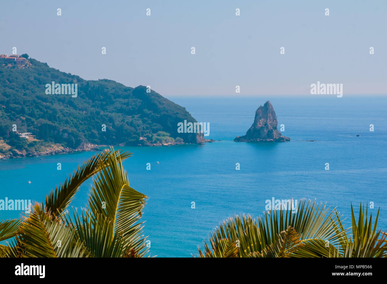 Bird s eye view of Palaiokastritsa bay in North Corfu Greece. Bay with clear crystal azur water. Europe trip concept - Stock Image