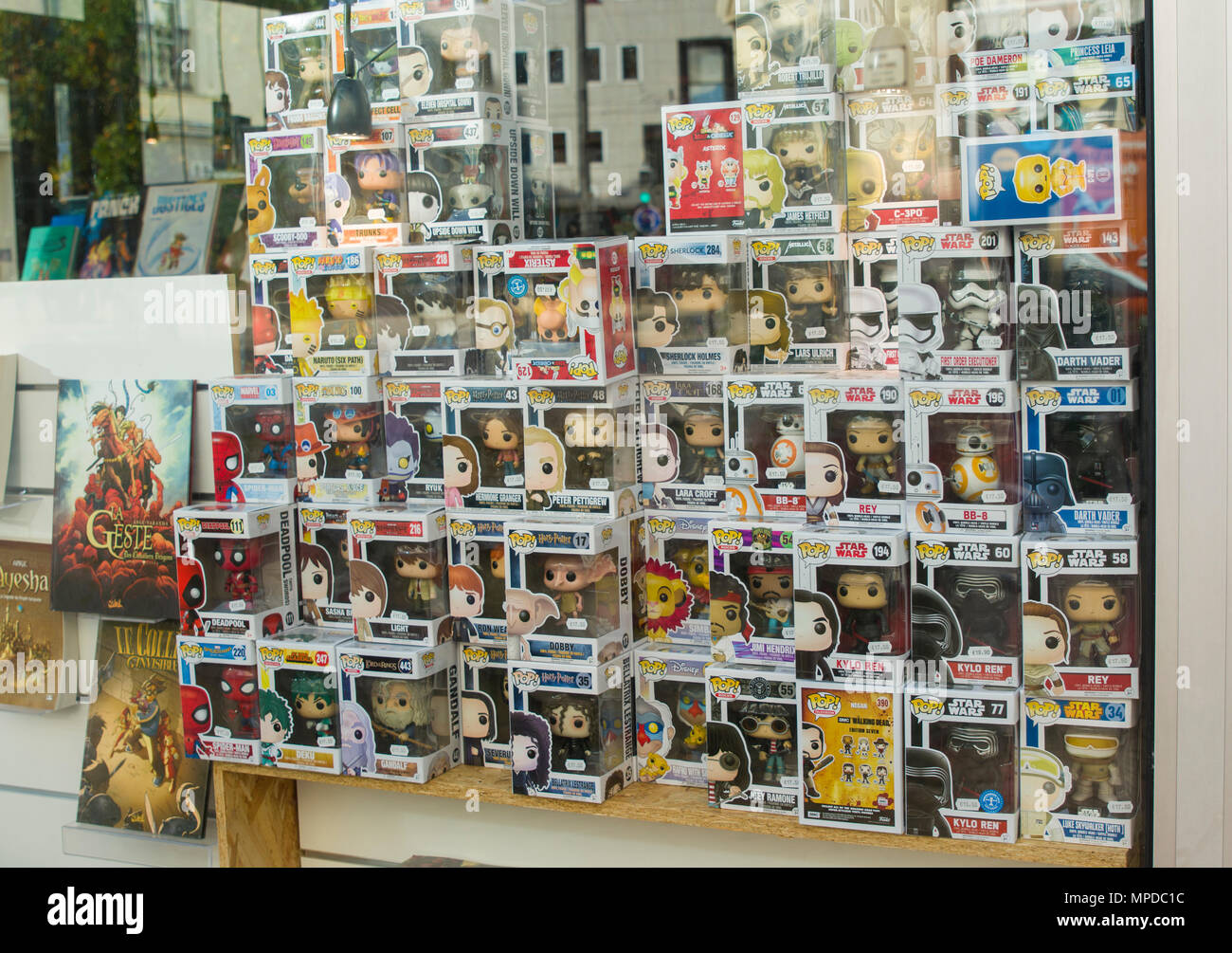 LE MANS, FRANCE - OCTOBER 08, 2017: Row of figures of American company Funko Pop in the shop window - Stock Image