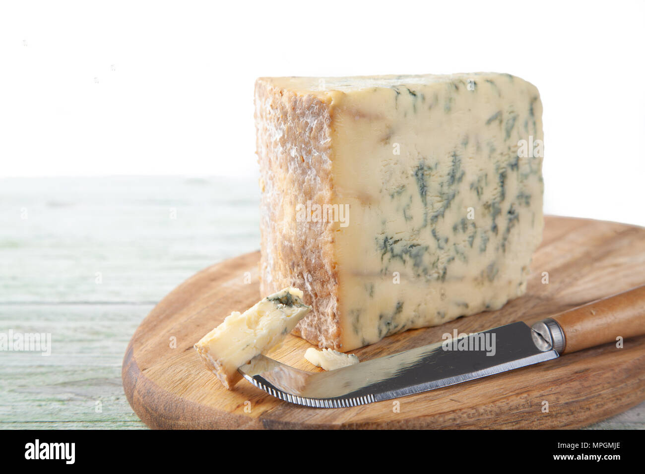 Wedge of Stilton Cheese on a Cheeseboard Stock Photo