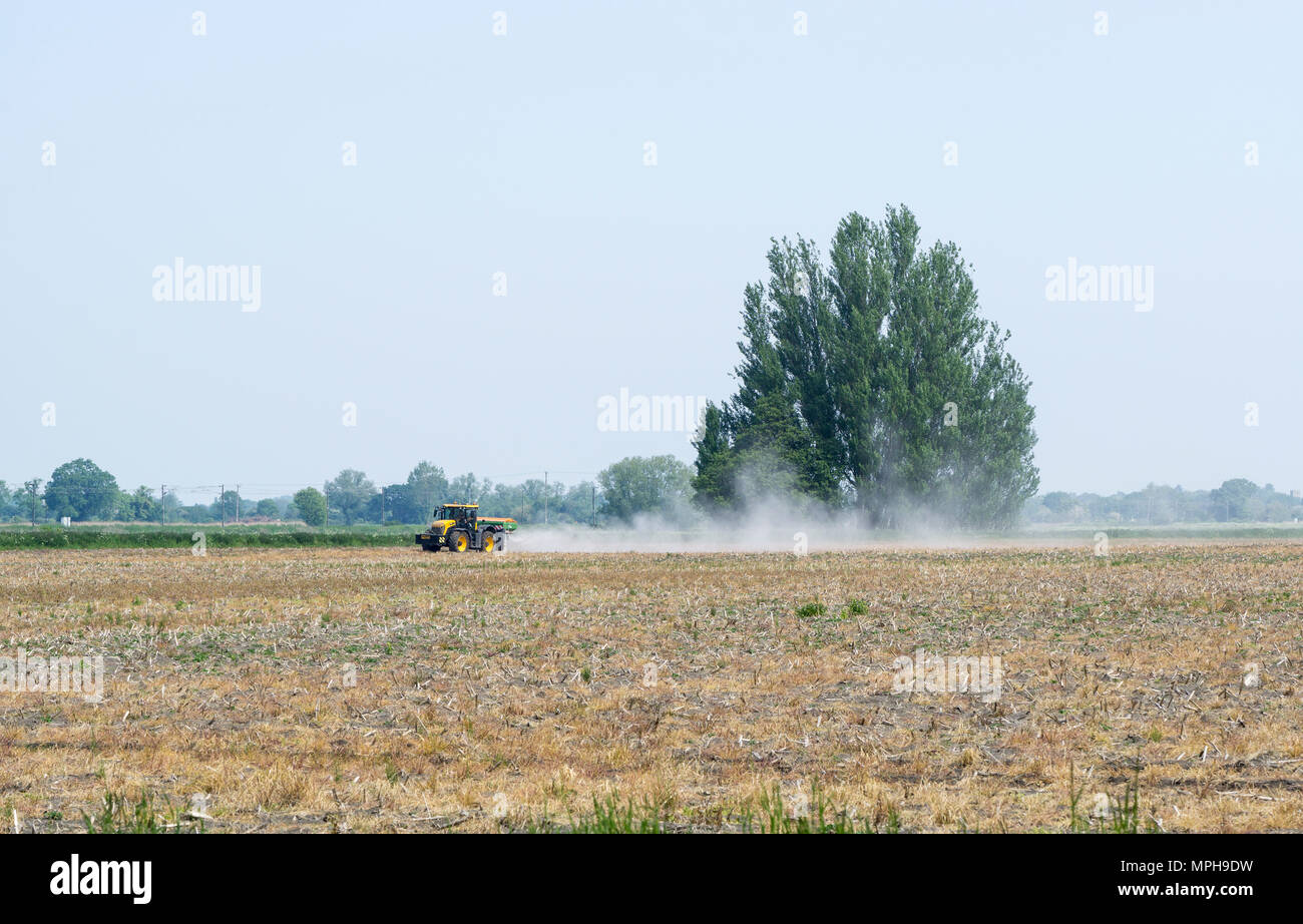 agricultural-vehicle-spreading-powder-on