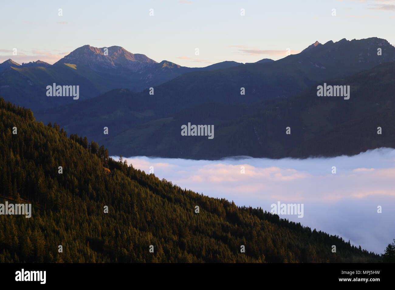 alpine-peaks-and-a-cover-of-clouds-in-th