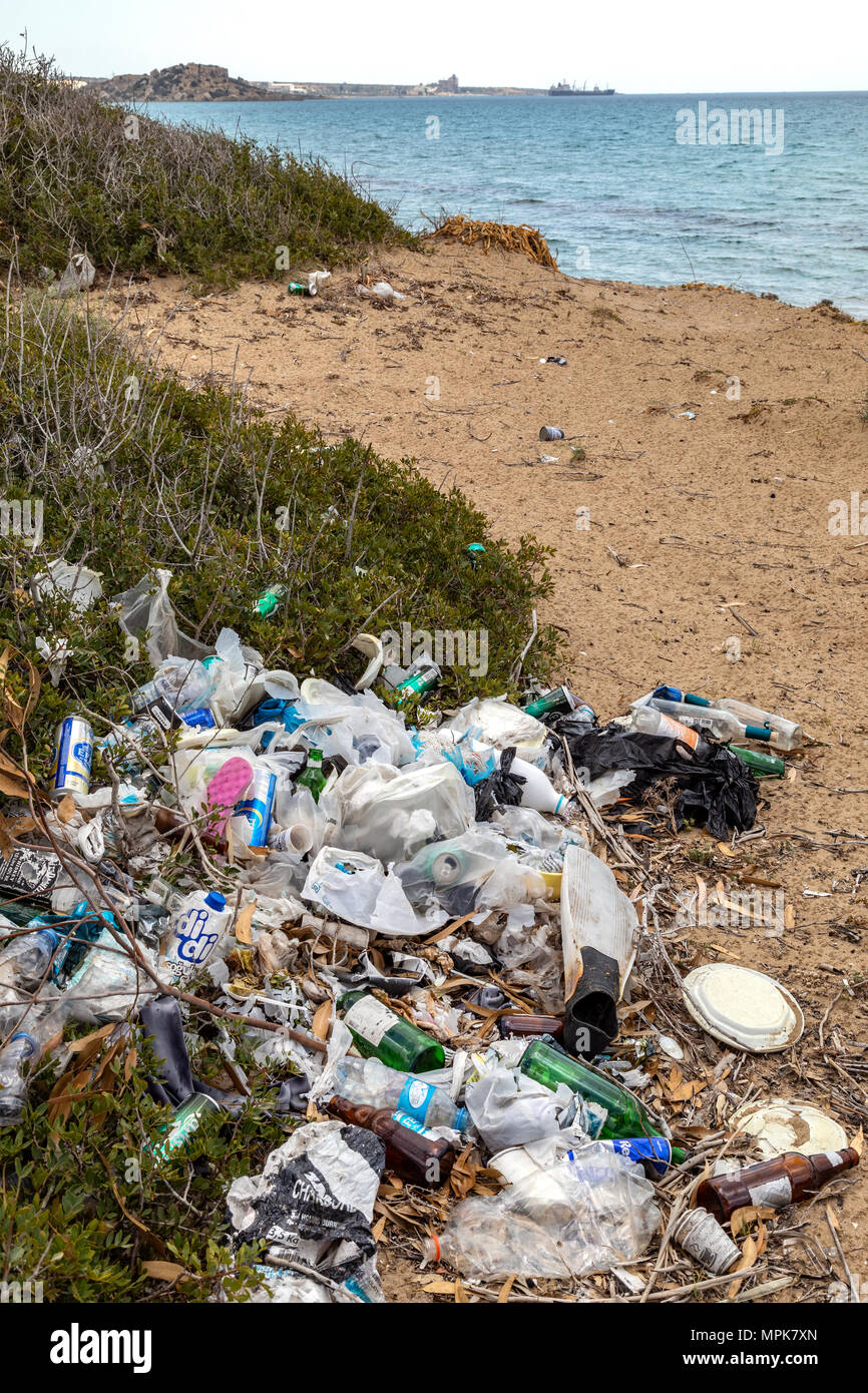 Pollution - Rubbish dumped on a beach in Cyprus. - Stock Image