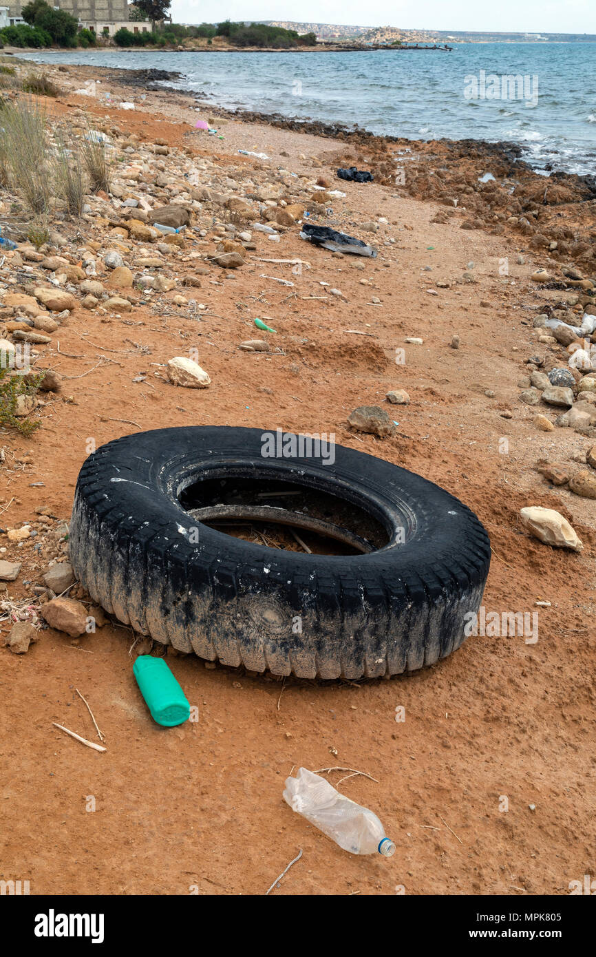 Pollution - Rubbish dumped on a beach in Cyprus - Stock Image