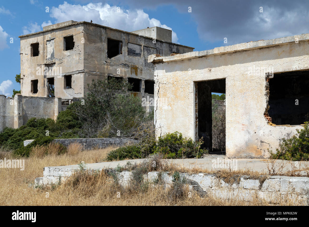 Abandoned buildings in Famagusta, Cyprus. During to the Turkish invasion of Cyprus in 1974, its inhabitants fled, when it came under Turkish control,  - Stock Image