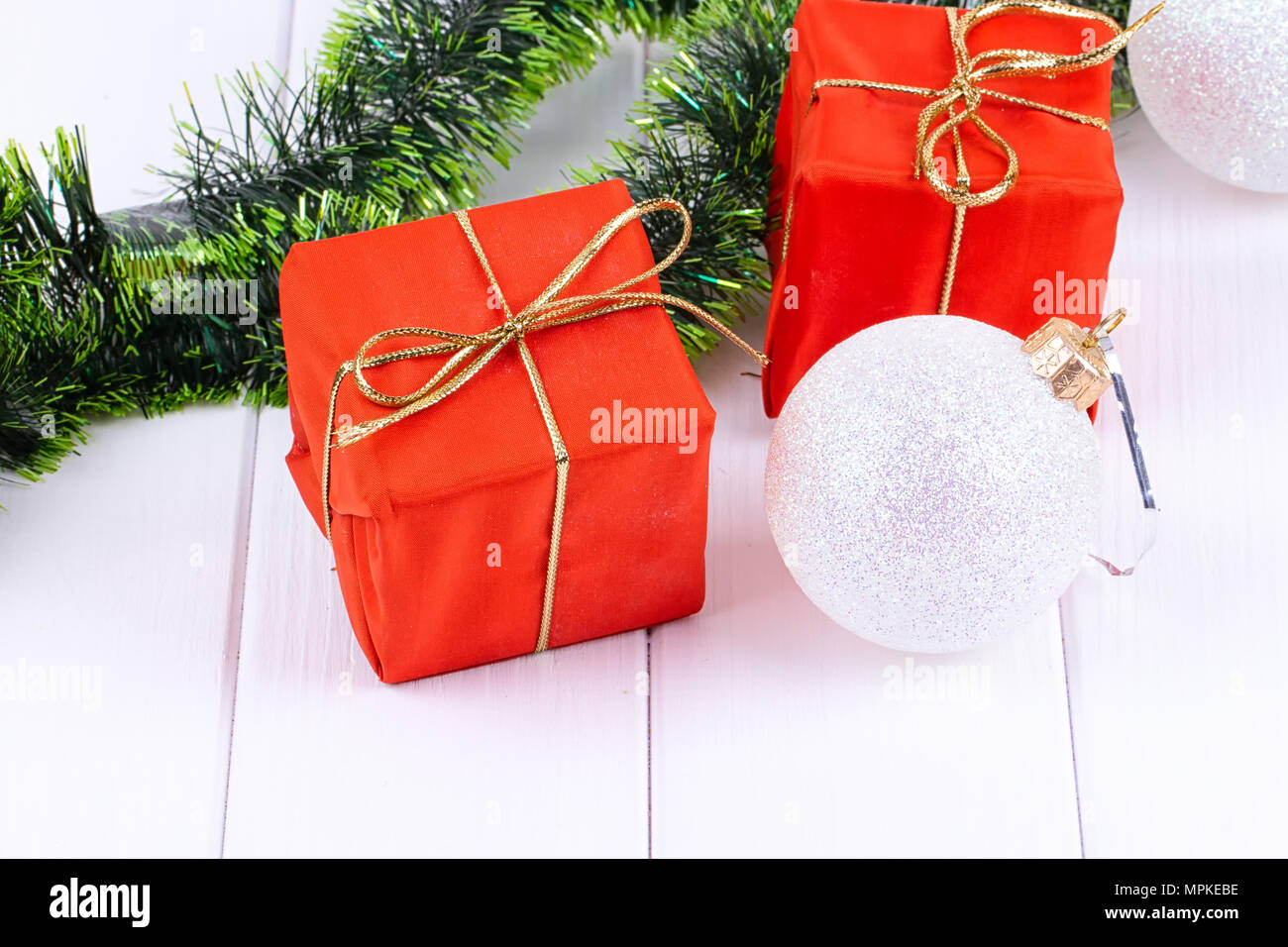 box with christmas gifts and christmas decorations on a white wooden background copy space for you text