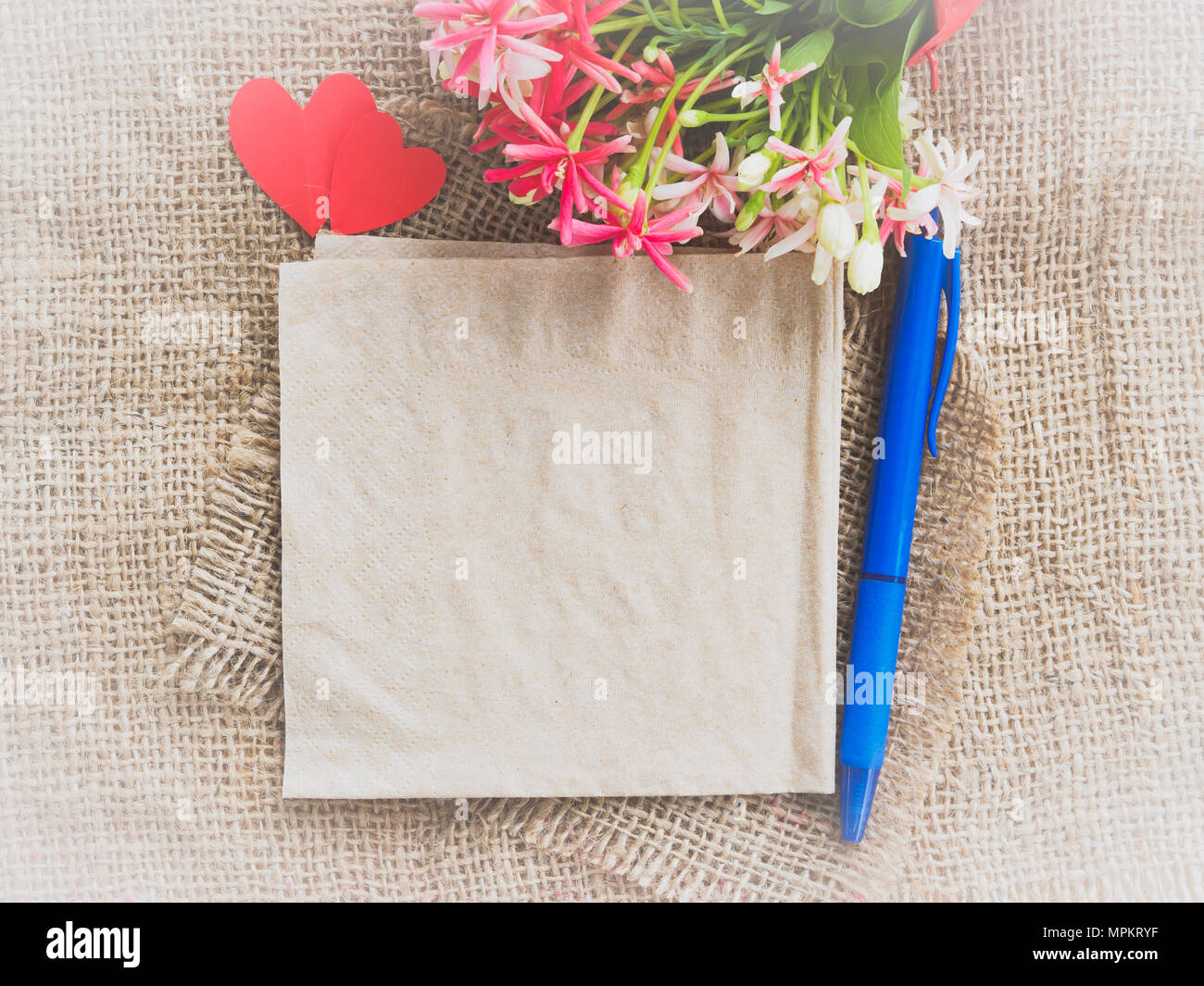 Poster mock up template with flower bouquet color paper in the poster mock up template with flower bouquet color paper in the shape of heart and blue pen on brown sack background izmirmasajfo