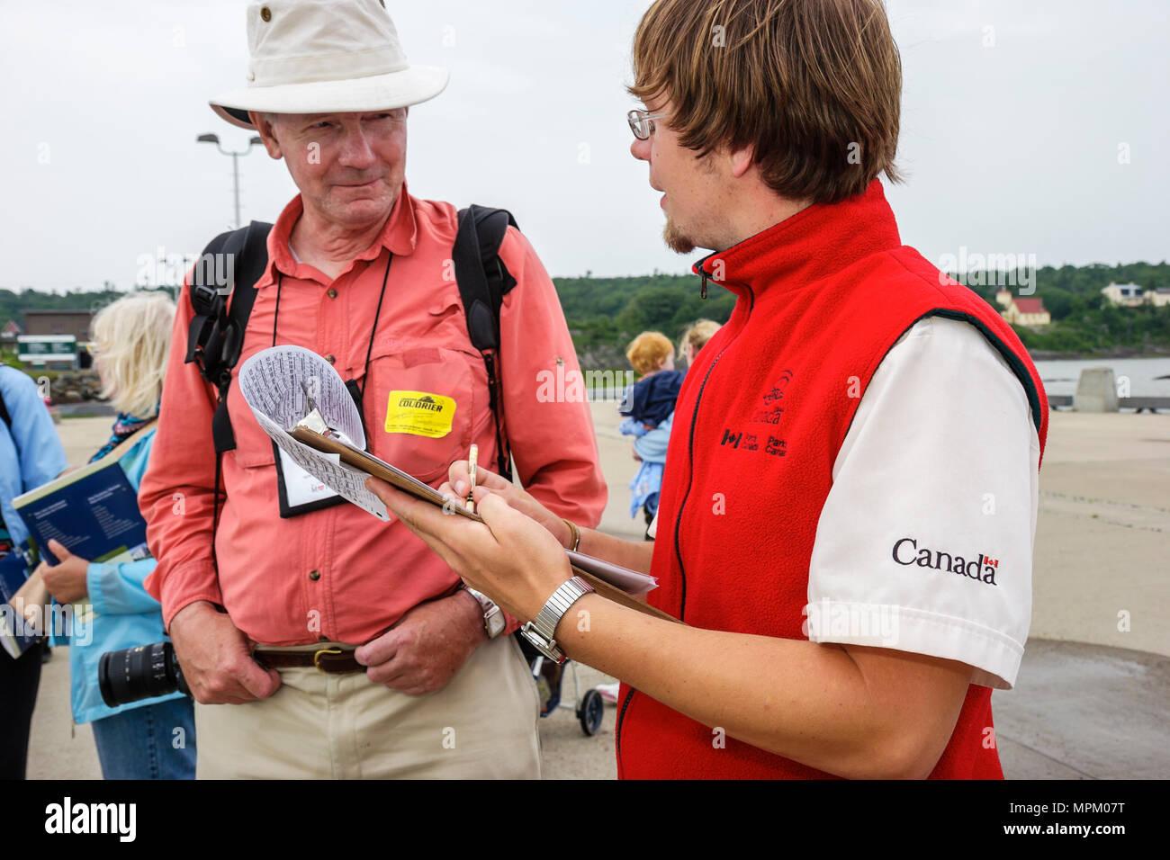 Canada Grosse Ile Irish Memorial National Historical Site park employee surveys writer about visit - Stock Image