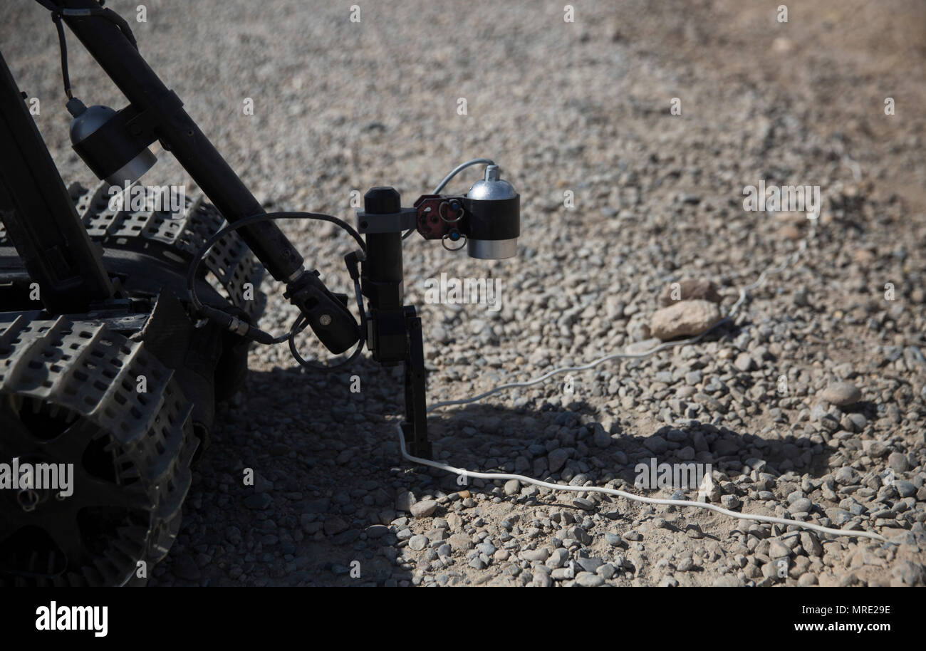 An Afghan engineer with the 505th Zone National Police remotely ...