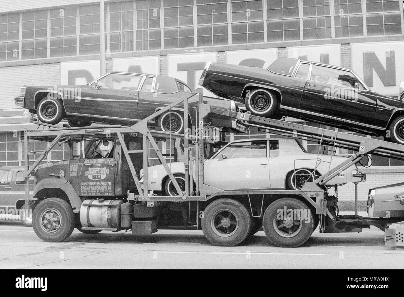 A car transporter with new cars being loaded in Chicago in 1980. Stock Photo