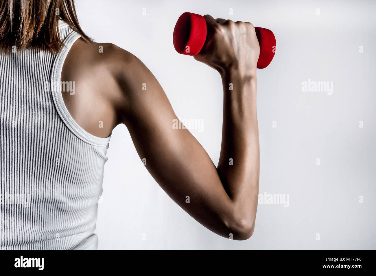female-back-and-muscle-hand-with-dumbbel