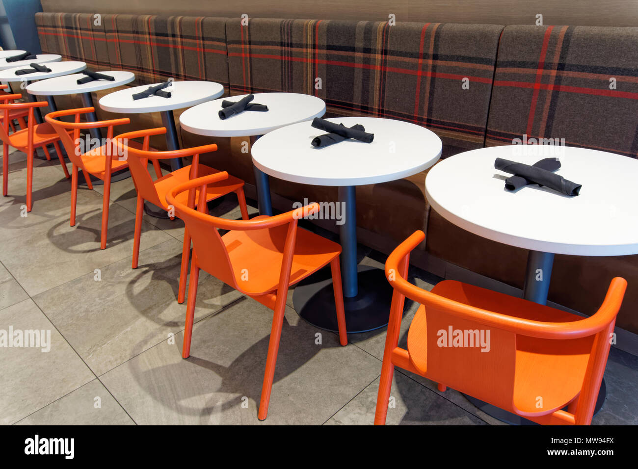 circular-white-cafe-tables-and-chairs-in