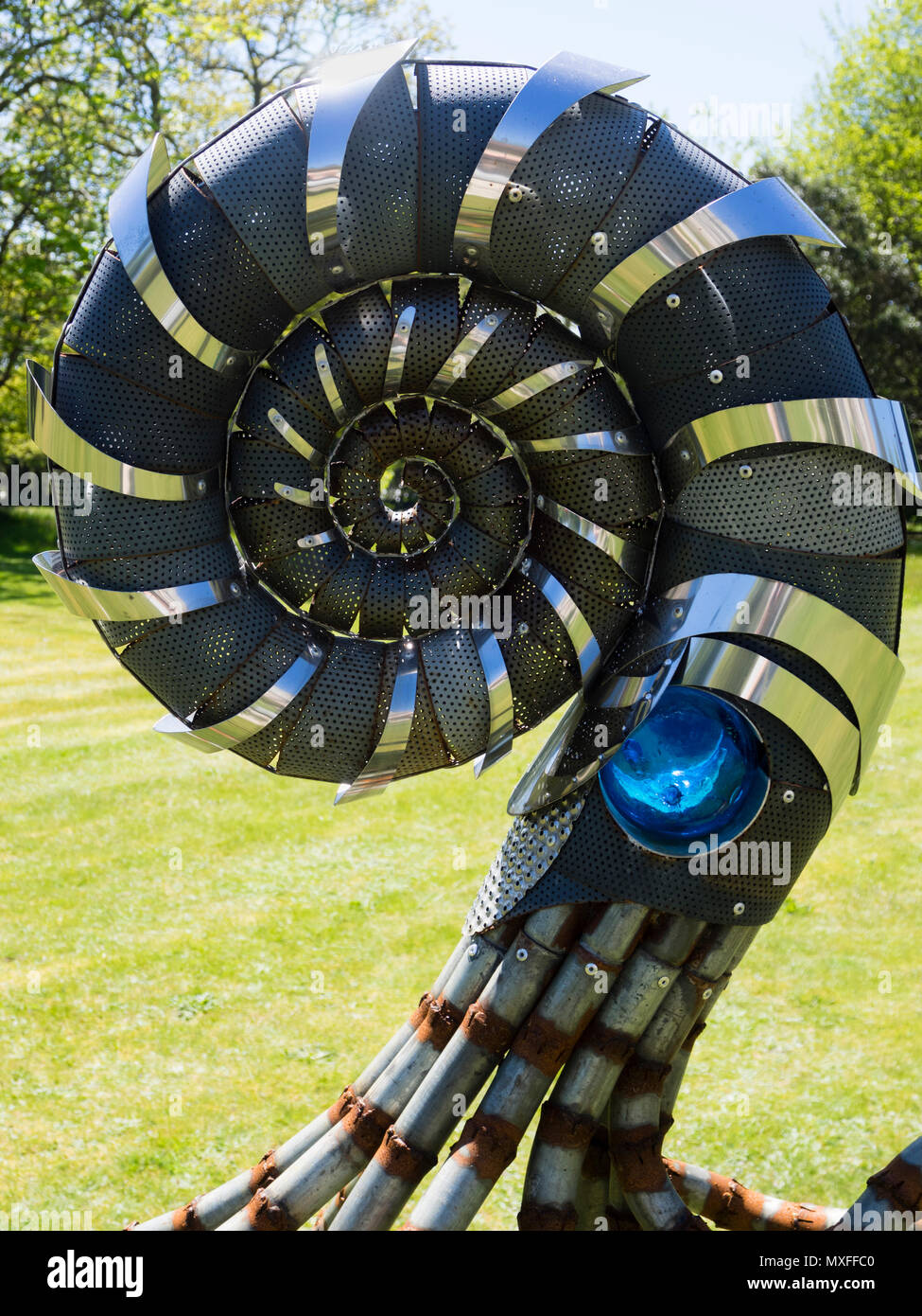 coil-detail-of-the-walking-ammonite-sculpture-by-glenn-martin-exhibited-on-the-lawn-at-delamore-arts-exhibition-devon-uk-2018-MXFFC0.jpg