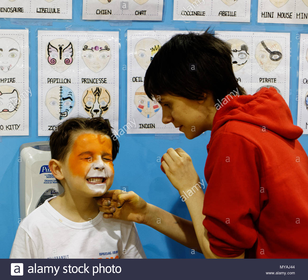 a-young-boy-6-yr-old-grimaces-while-being-face-painted-MYAJ44.jpg