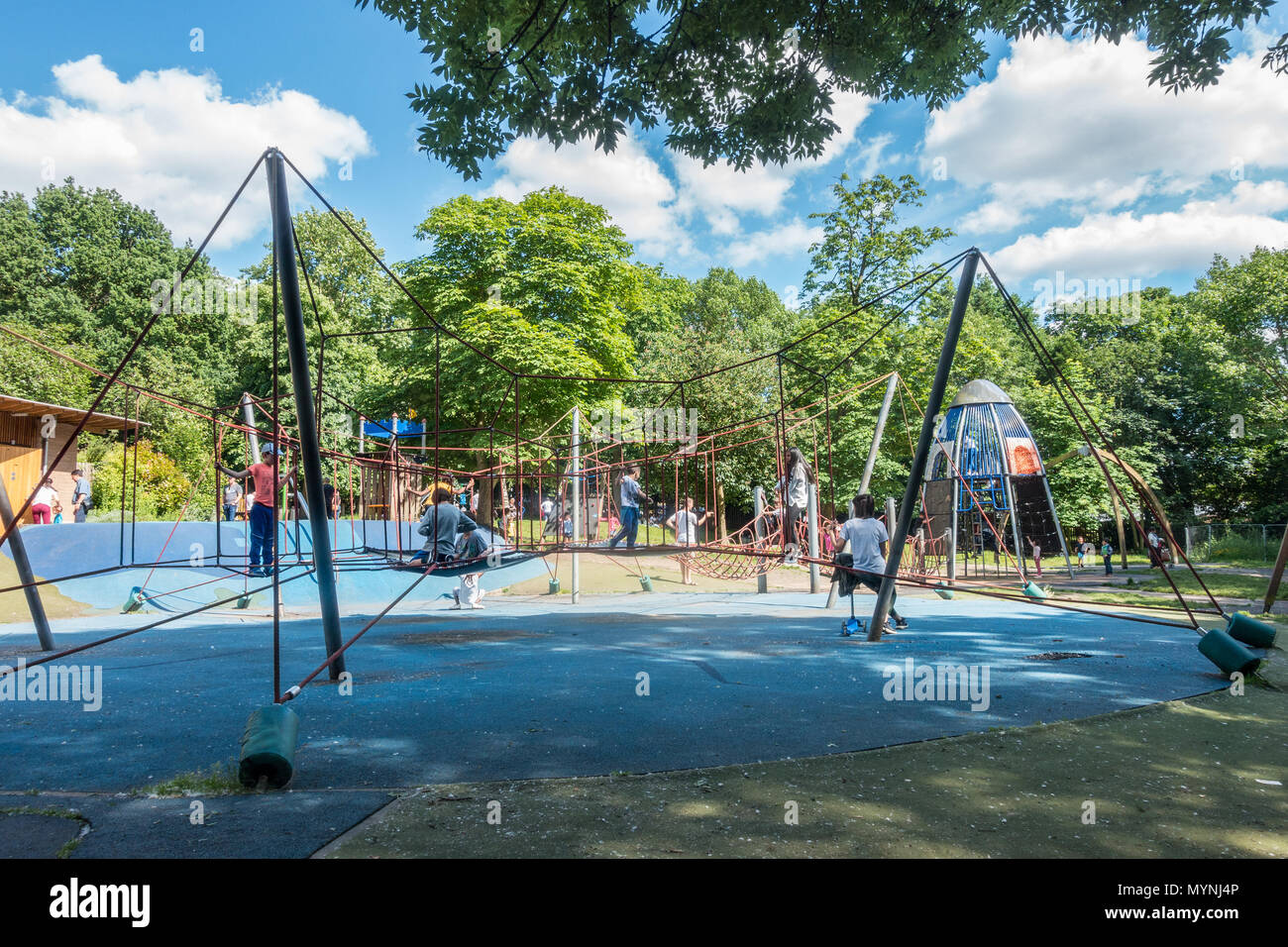 children-playing-in-an-adventure-playground-on-holland-park-in-london-uk-MYNJ4P.jpg