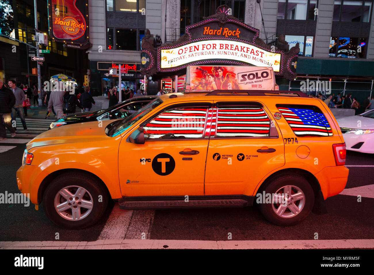 a-yellow-new-york-taxi-cab-reflecting-the-american-flag-times-square-new-york-cityusa-MYRM5F.jpg
