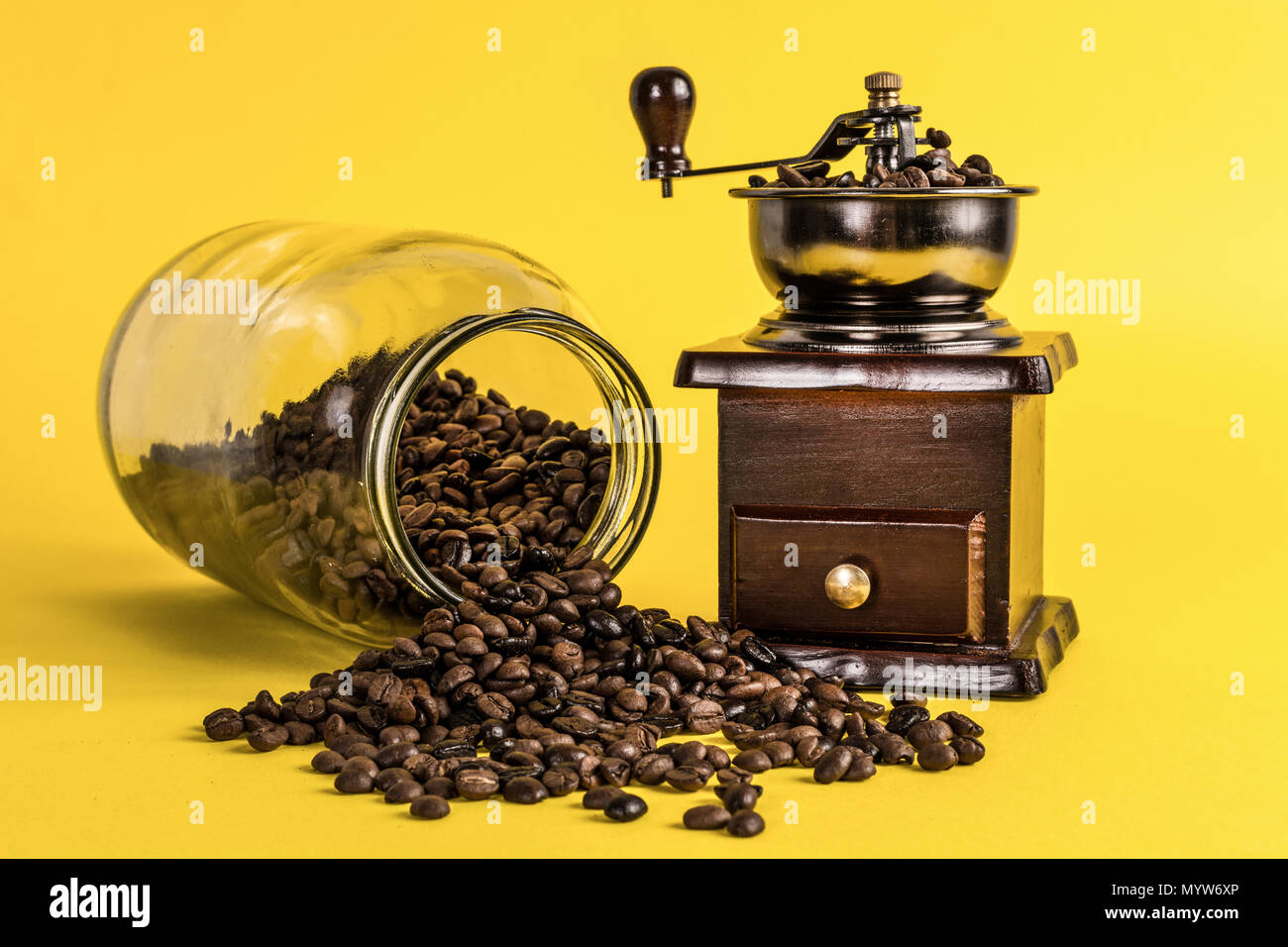 coffee-grinder-and-spilled-roasted-beans