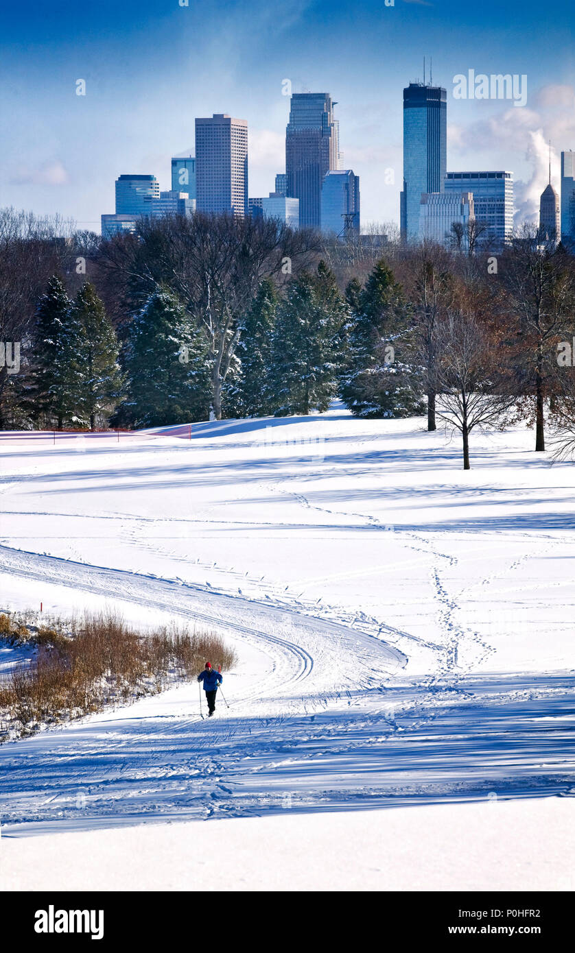 A cross country skier moves through Theodore Wirth Park in Minneapolis, Minnesota. Stock Photo