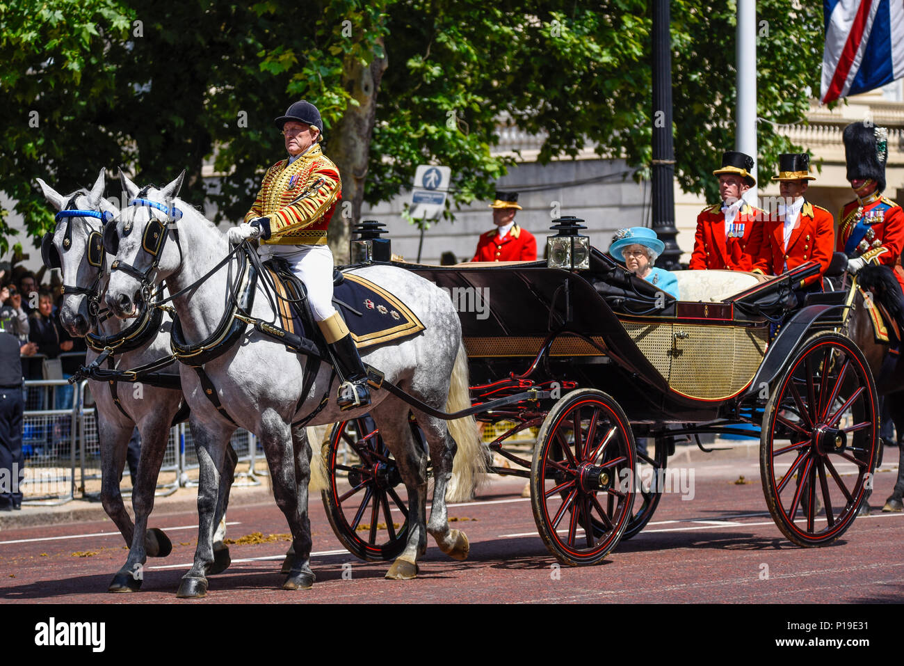 the-queen-at-trooping-the-colour-2018-with-head-coachman-philip-barnard-brown-leading-the-mall-london-uk-P19E31.jpg